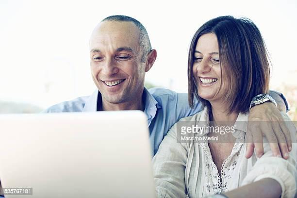 Mature couple using laptop