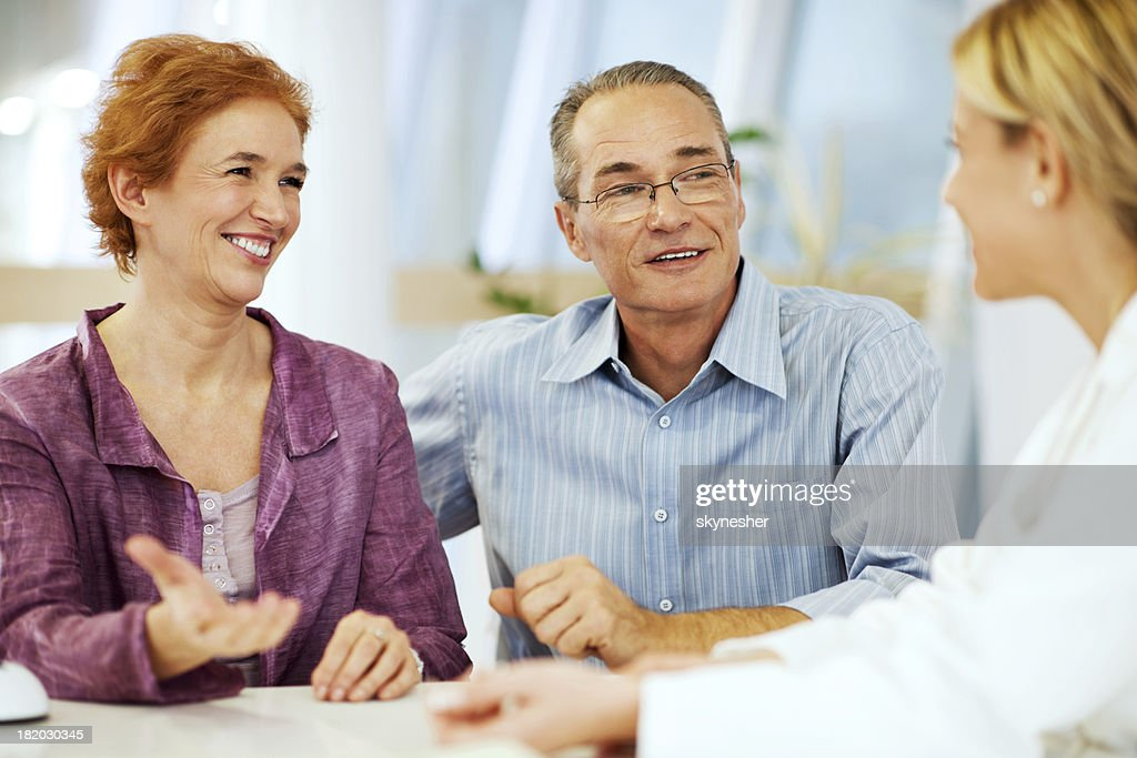 Mature couple visiting a doctor. : Stock Photo