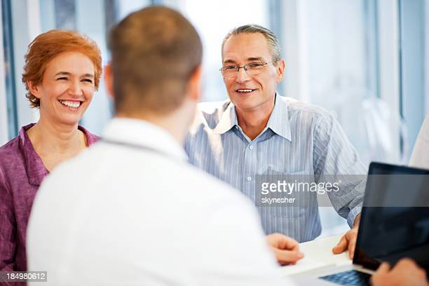 Mature couple visiting a doctor.