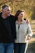 Mature couple walking together and smiling