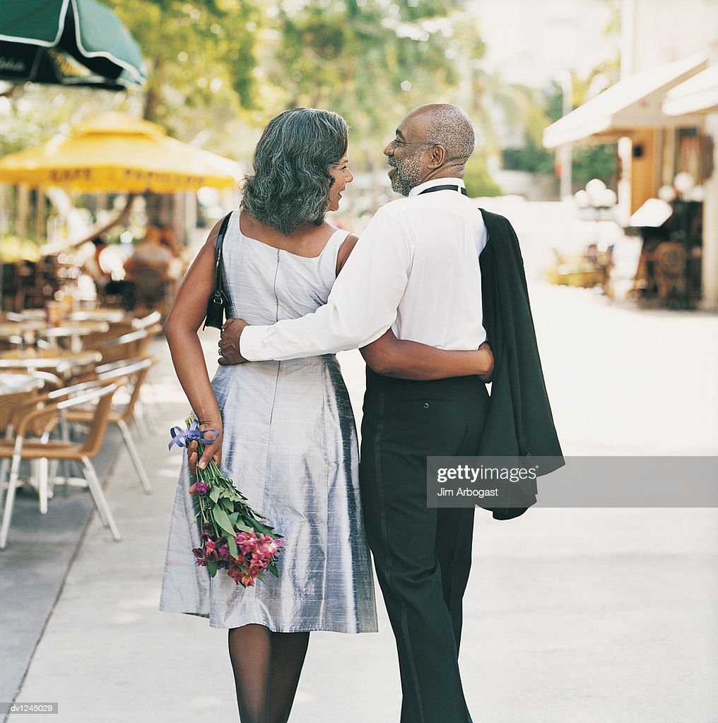 Mature Couple Walking With Arms Around Each Other The ...