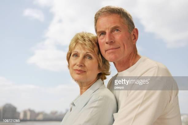 mature couple wearing white gazing afar