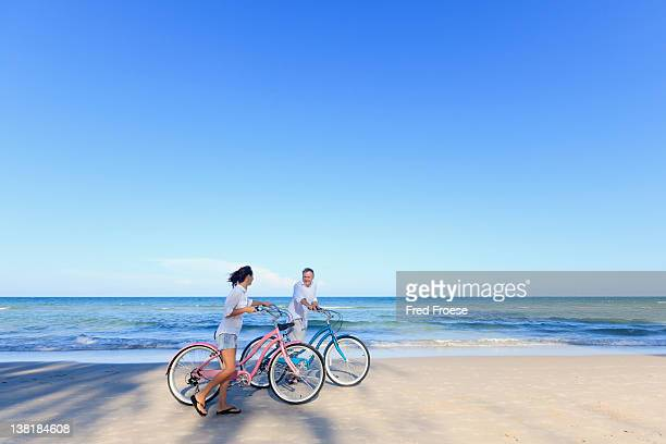 Mature Couple with bikes on beach