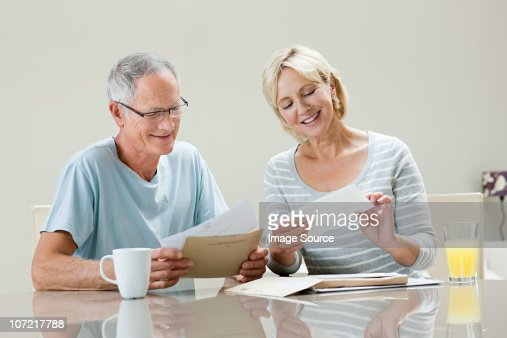 Mature couple with letters : Stock Photo