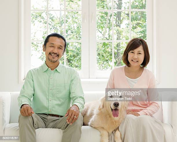 Mature Couple With Pet Dog