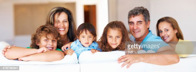 Mature couple with their kids smiling