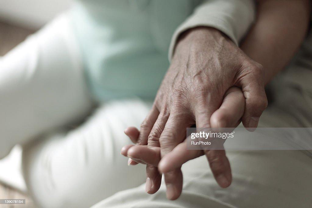 Mature couple's hands, close-up