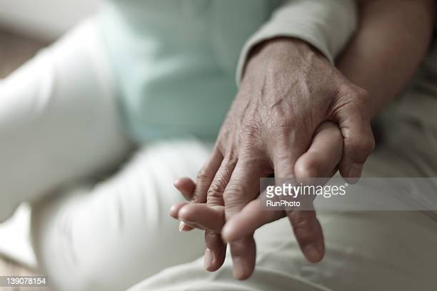 Mature couple's hands, close-up