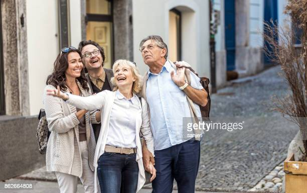 Mature Couples Looking Around Old Town
