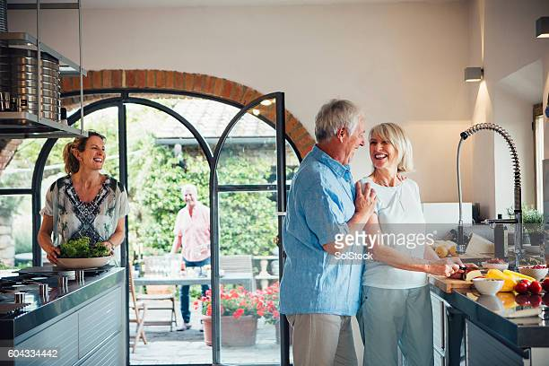 Mature Couples Preparing for a Dinner Party