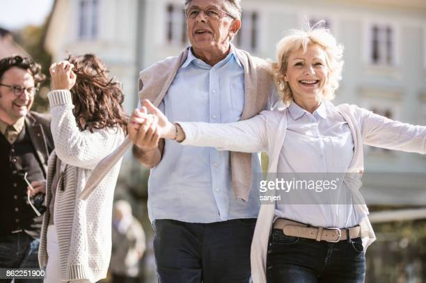 Mature Couples Walking Around Old Town