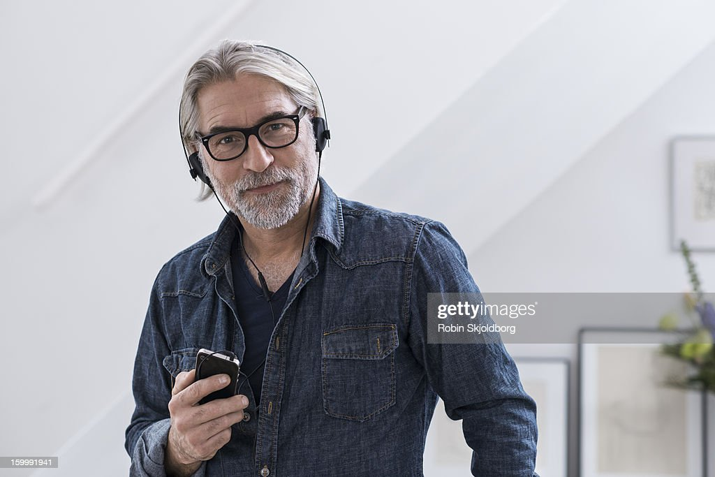 Mature creative man wearing headset : Stock Photo