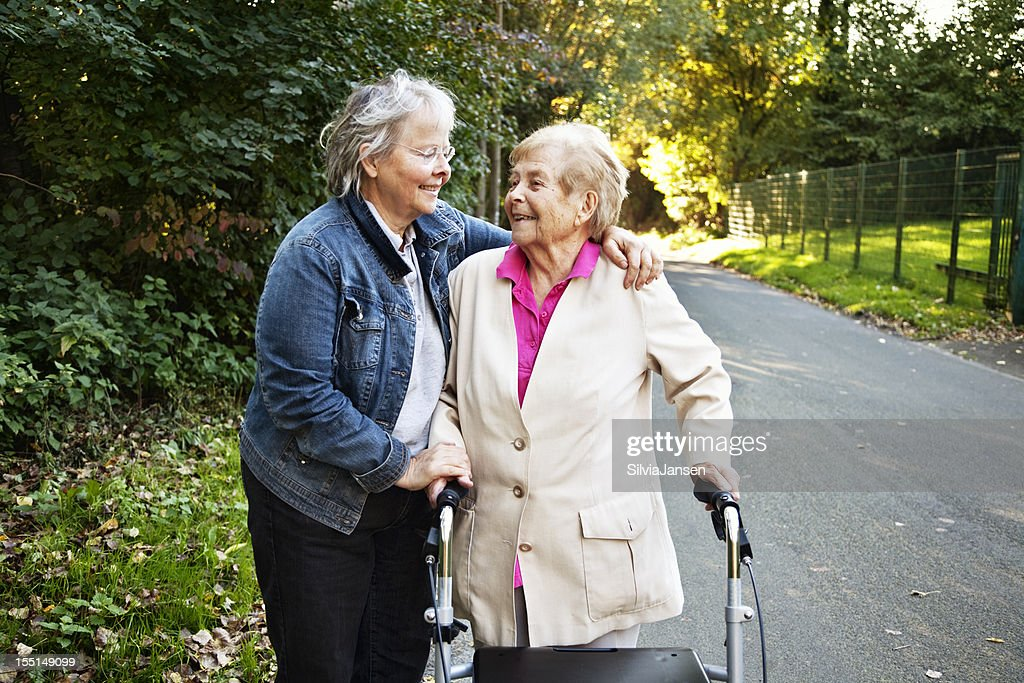 mature daughter and old mother embrace