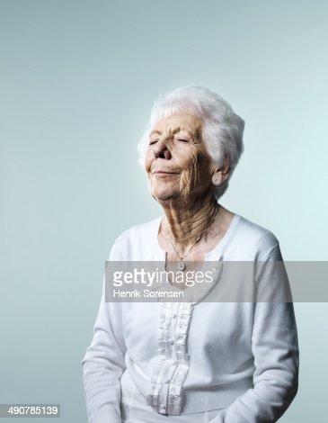 Mature daydreaming woman