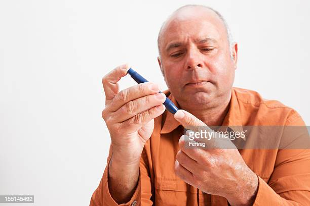 Mature diabetic man checking his blood sugar