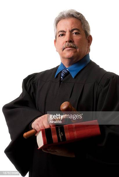 Mature distinguished judge with gavel and law book on white