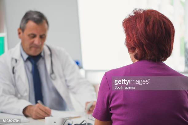 Mature doctor and a patient