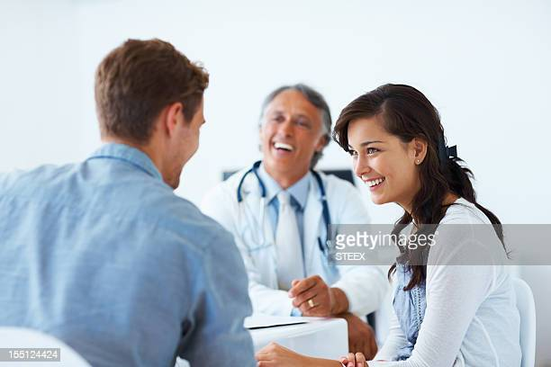 Mature doctor and patients having a conversation