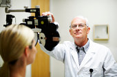 mature doctor checking a patient's vision