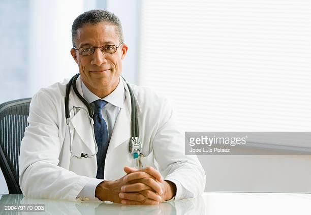 Mature doctor smiling, portrait