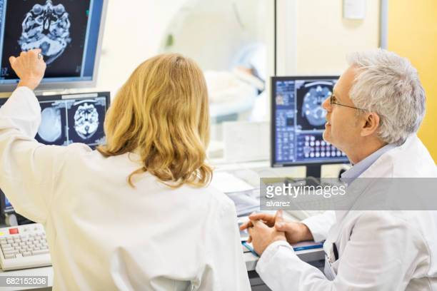 Mature doctors analyzing X-ray image at hospital