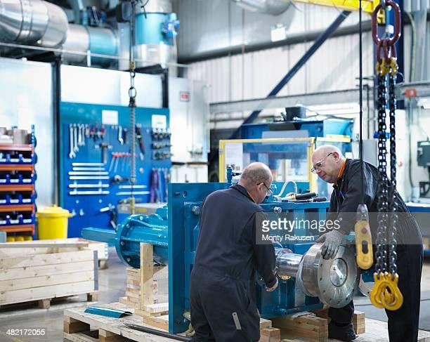Mature engineers working in engineering factory