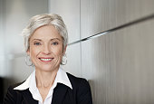 Mature executive business woman smiling
