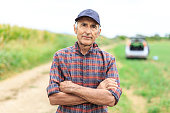 Mature farmer in the field - crossed arms