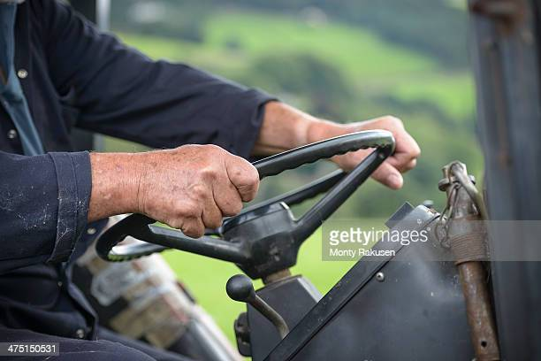 Mature farmer in tractor cab, close up