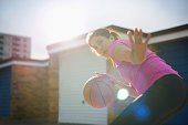 Mature female basketball player practicing defense
