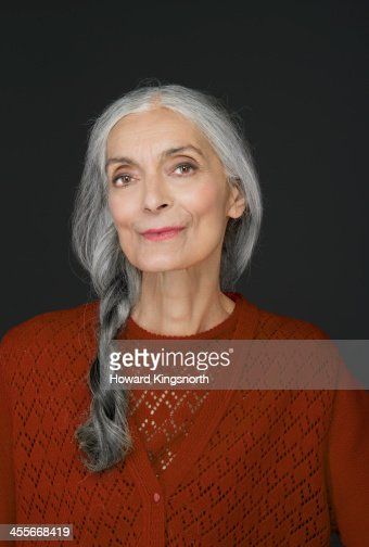 mature female beauty with braid looking at camera : Stock Photo