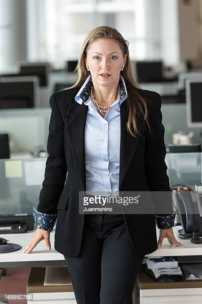A mature female business executive posing at the office