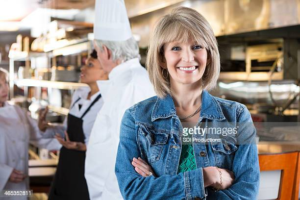Mature female business owner in her restaurant