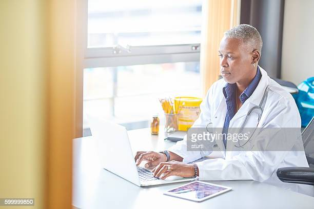 mature female doctor in her office