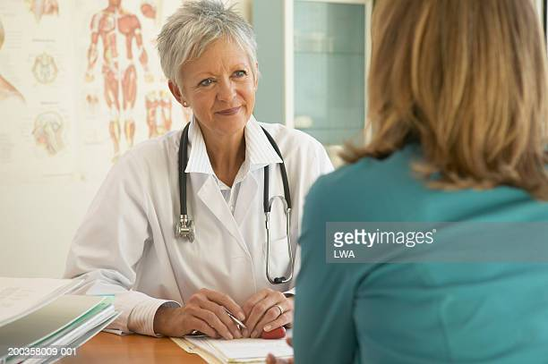 Mature female doctor meeting with woman