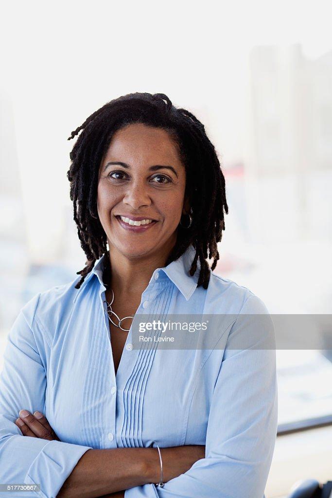 Mature female executive in office, portrait