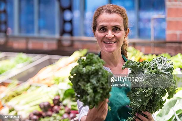 Mature female grocery store worker