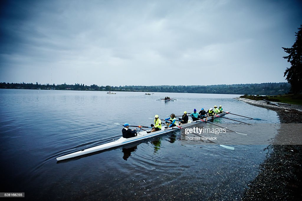 Mature female rowers preparing to practice