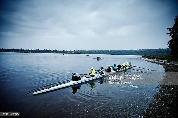 Mature female rowers preparing to practice