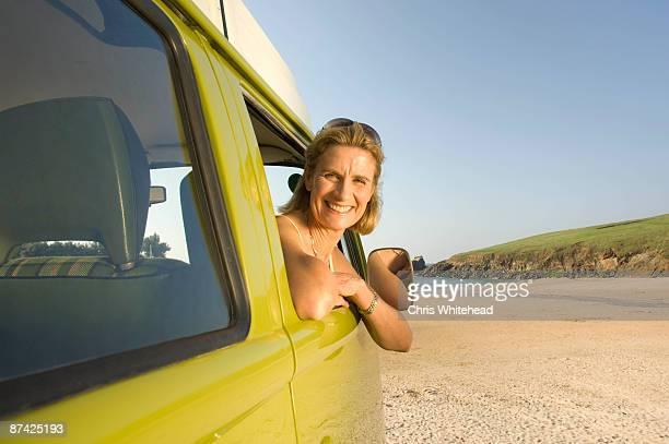 Mature female sat in camper van