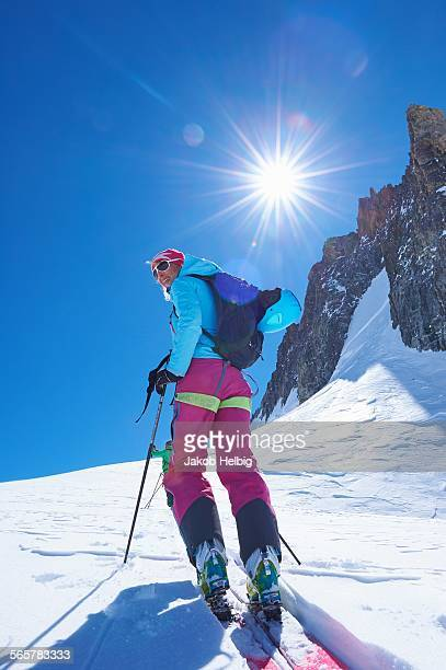 Mature female skier moving up Mont Blanc massif, Graian Alps, France