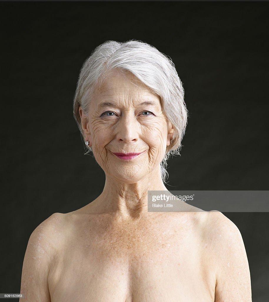 Mature female smiling closeup studio