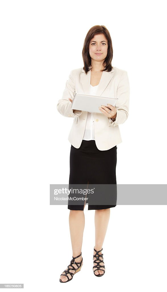 Mature female worker taking notes on a digital tablet