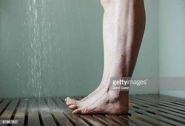 mature female's legs in shower,toes curled