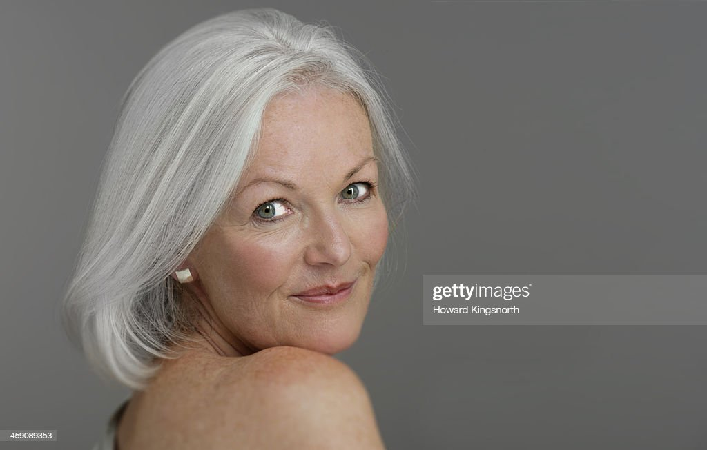 mature glamorous woman smiling : Stock Photo