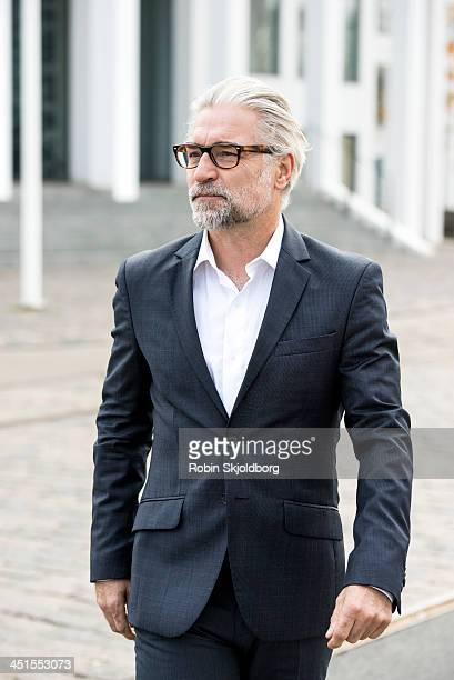 Mature grey-haired man in suit