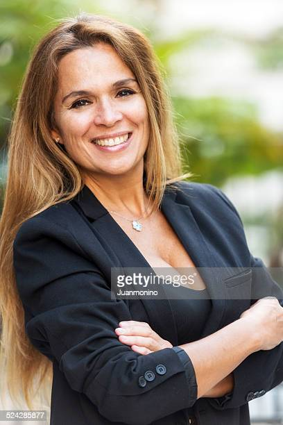 Mature hispanic business woman smiling
