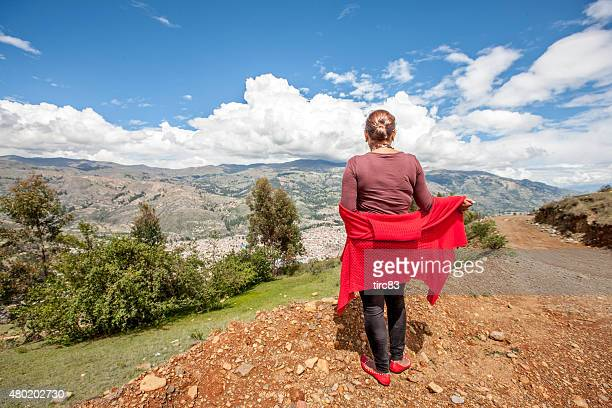 Mature hispanic woman rear view in the Andes above Huaraz
