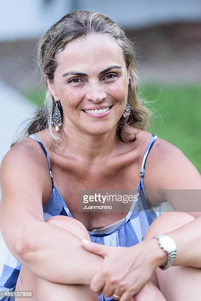 Mature hispanic woman smiling