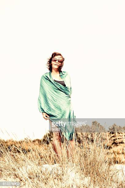 Mature hispanic woman standing in dunes